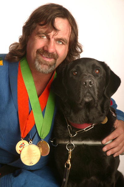 Anthony Clarke with his guide dog